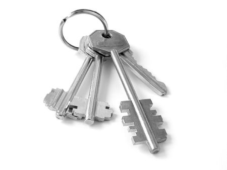 bunch of keys from door locks on the white background                                photo