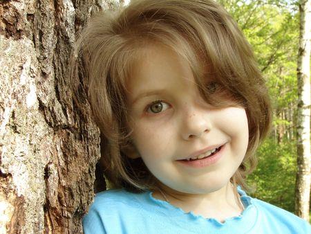 naivete: outdoor portrait of the little pretty girl