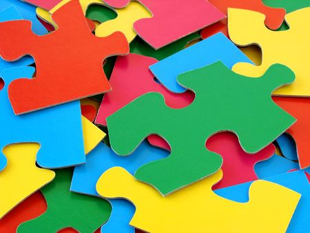 close-up of the scattered colorful puzzles details                                photo