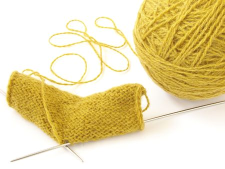 plain stitch: clew of the wool threads and knitting pattern