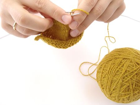 plain stitch: hands with knitting close-up