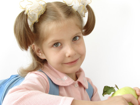 little pretty schoolgirl with blue satchel and apple