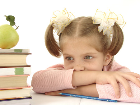 little pretty thoughtful girl with pile of books                                photo