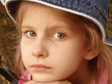 naivete: little pretty girl autumnal mood portrait