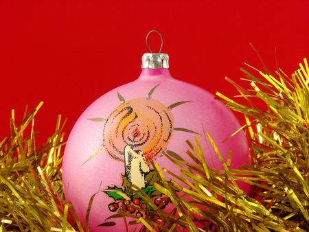 pink christmas bauble with golden tinsel                                photo