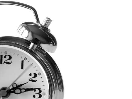 classic alarm clock fragment at the white background                                Stock Photo