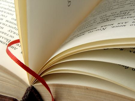 open old book fragment with red bookmark                                Stock Photo