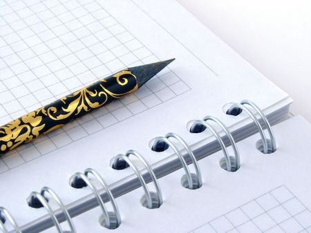decorative pencil on spiral notebook page Stock Photo - 2511900
