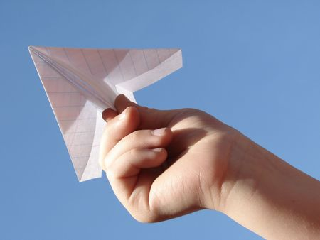 child hand with paper plane                                Stock Photo