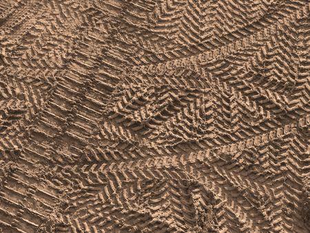 crisscross: warm toned crisscross tire tracks on construction site as a background                               Stock Photo