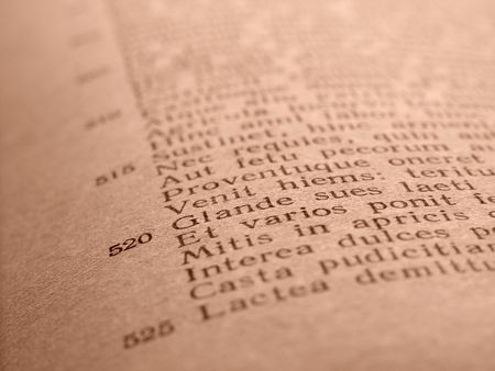 poem: old book page with ancient Latin poem fragment  ( Virgils Georgicon )                                Stock Photo
