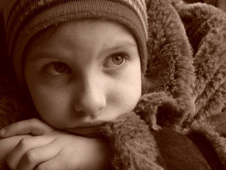 naivete: little pretty girl in winter coat and hat