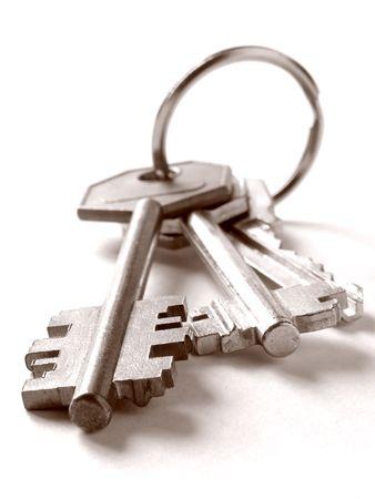 home key: tonos sepia manojo de llaves en blanco Foto de archivo