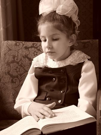 sepia toned reading schoolgirl