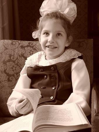 schoolgirl with open book sepia toned portrait