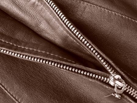 fragment: sepia toned leather jacket fragment with metal zipper