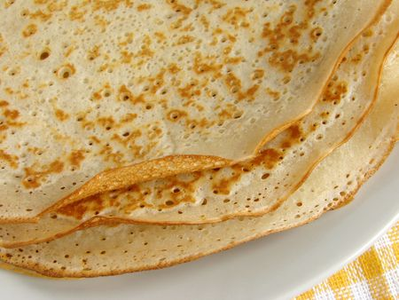 shrove tuesday: some pancakes fragment on plate                       Stock Photo