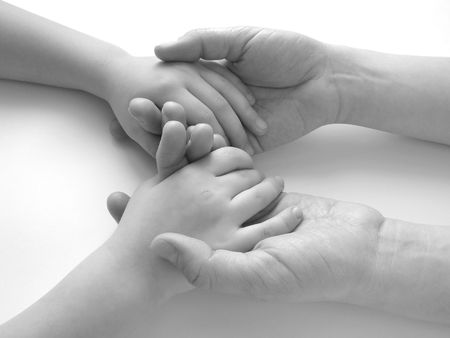 child hands in mother's ones                                Stock Photo - 4450530