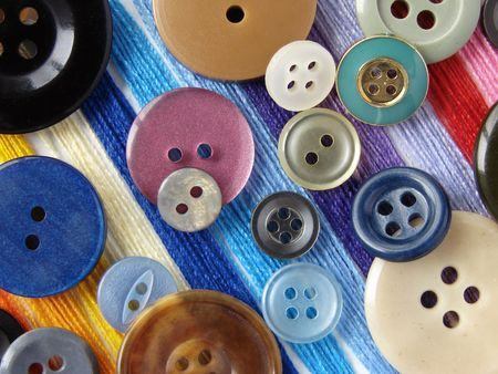 needlecraft: scattered colorful buttons needlecraft background