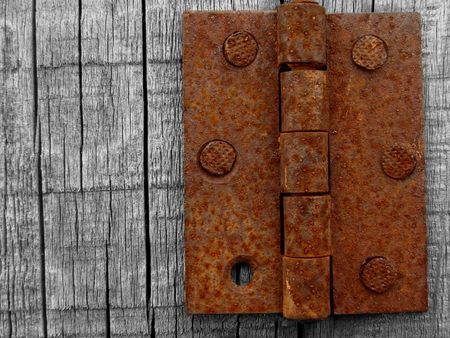 old wooden background with rusty hinge