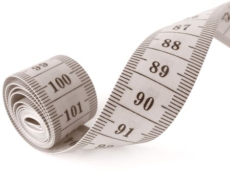 width: sepia toned curved measuring tape fragment