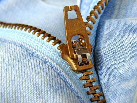 zipper: blue denim clothes fragment with zipper                                Stock Photo