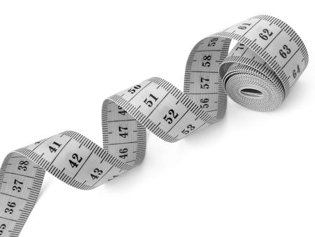 fragment: curved measuring tape fragment on white                                Stock Photo