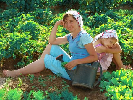mother and daughter resting together at the garden Stock Photo - 5063007
