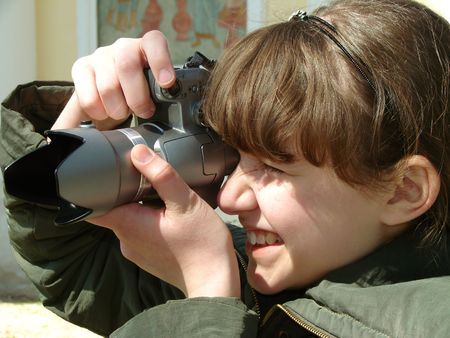 photography session: teenager girl shooting with digital camera