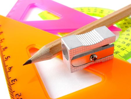 delineate: colorful rulers set and pencil with sharpener                                Stock Photo