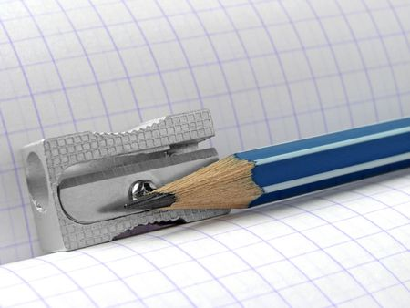 delineate: sharpener and pencil on the workbook page