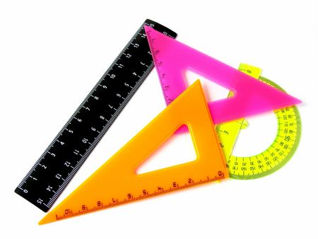 delineate: colorful rulers set on white