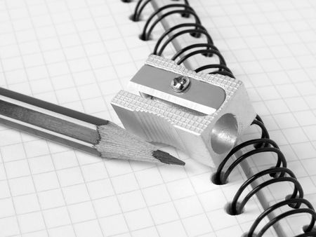 sharpener and pencil on the workbook page Stock Photo - 5453062