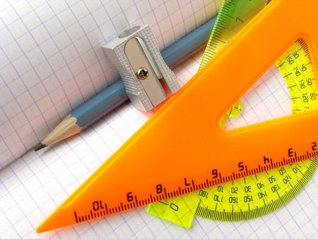 tutorials: pencil and sharpener with triangle on the workbook page                                Stock Photo