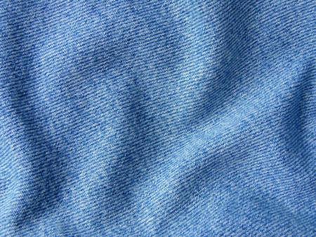 jeansstoff: gefaltet Jeanskleidung Fragment als Hintergrund Lizenzfreie Bilder