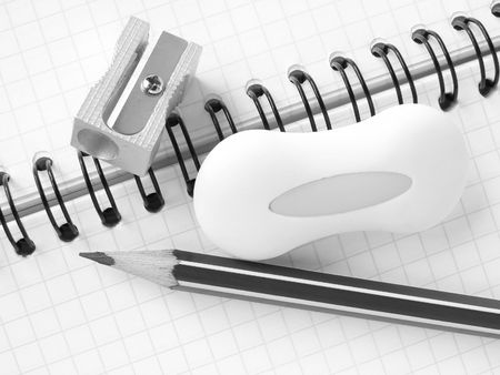 delineate: sharpener and pencils with eraser on the spiral notepad page in black and white                               Stock Photo