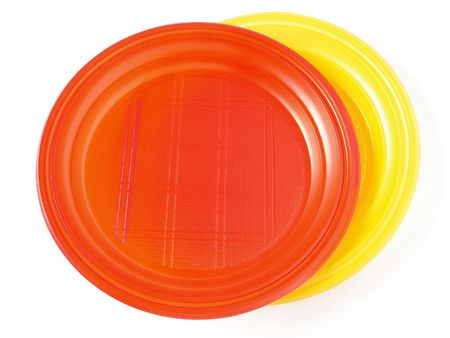 red and yellow disposable plates on white                                photo