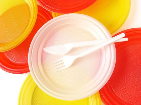 throwaway: colorful disposable tableware set on white