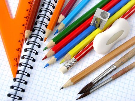 educational tools: educational tools set on the spiral notepad background