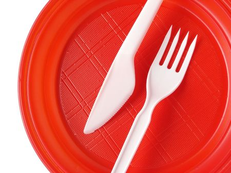 food supply: red disposable plate with fork and knife                                Stock Photo