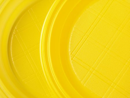 yellow disposable plates as abstract background                                photo