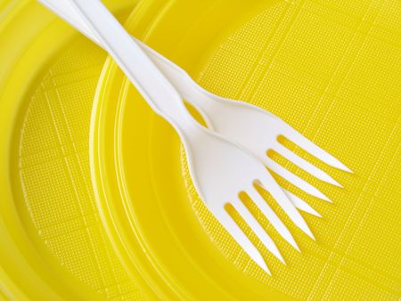 yellow disposable plates with forks                                 photo