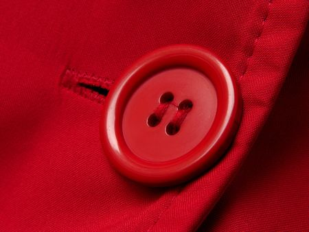 red button with shallow DOF red clothes background                                photo