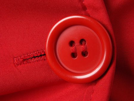 red clothes fragment with button                    photo