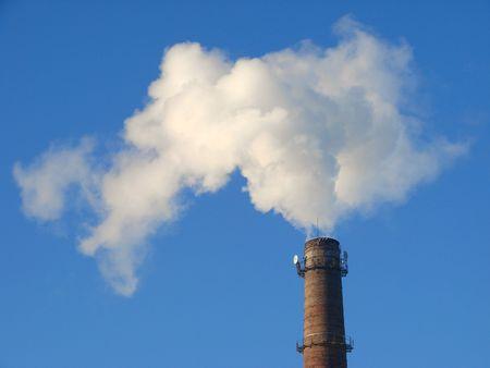 fuming tube against blue sky                                photo