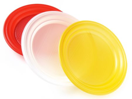 three colorful disposable plates on white                                photo