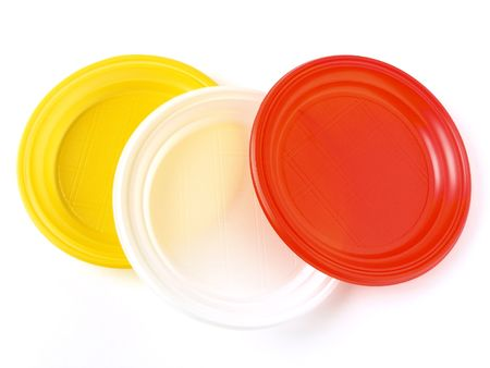colorful disposable plates on white                                photo