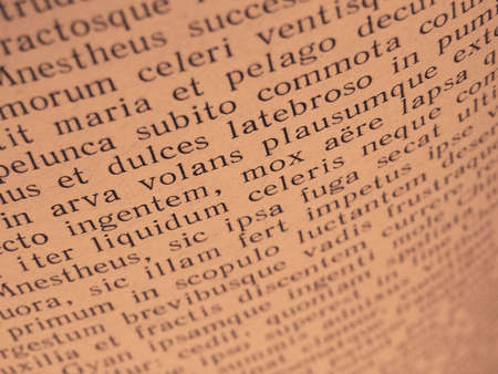 latin language: warm toned open book page with ancient latin text of Aeneid by Virgil