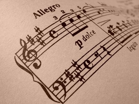 allegro: sepia toned sheet of musical notes fragment                                Stock Photo