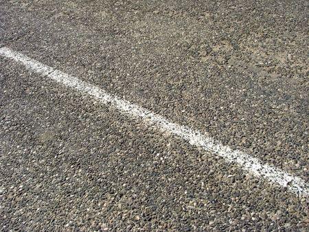 median: old asphalt road with median strip